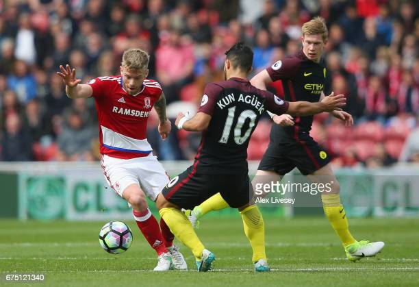 Adam Clayton of Middlesbrough attempts to get past Sergio Aguero of Manchester City during the Premier League match between Middlesbrough and...