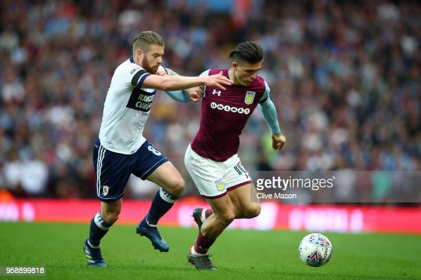 Adam Clayton of Middlesbrough battles for possession with Jack Grealish of Aston Villa during the Sky Bet Championship Play Off Semi Final second leg...