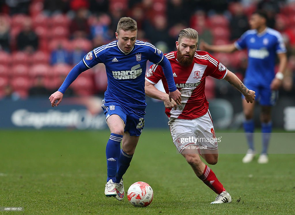 Adam Clayton of Middlesbrough challenges Freddie Sears of Ipswich Town during the Sky Bet Championship match between Middlesbrough and Ipswich Town at the Riverside Stadium on March 14, 2015 in Middlesbrough, England.