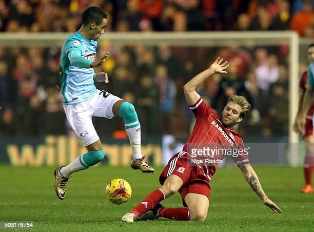 Adam Clayton of Middlesbrough challenges Tom Ince of Derby County during the Sky Bet Championship soccer match between Middlesbrough and Derby County...