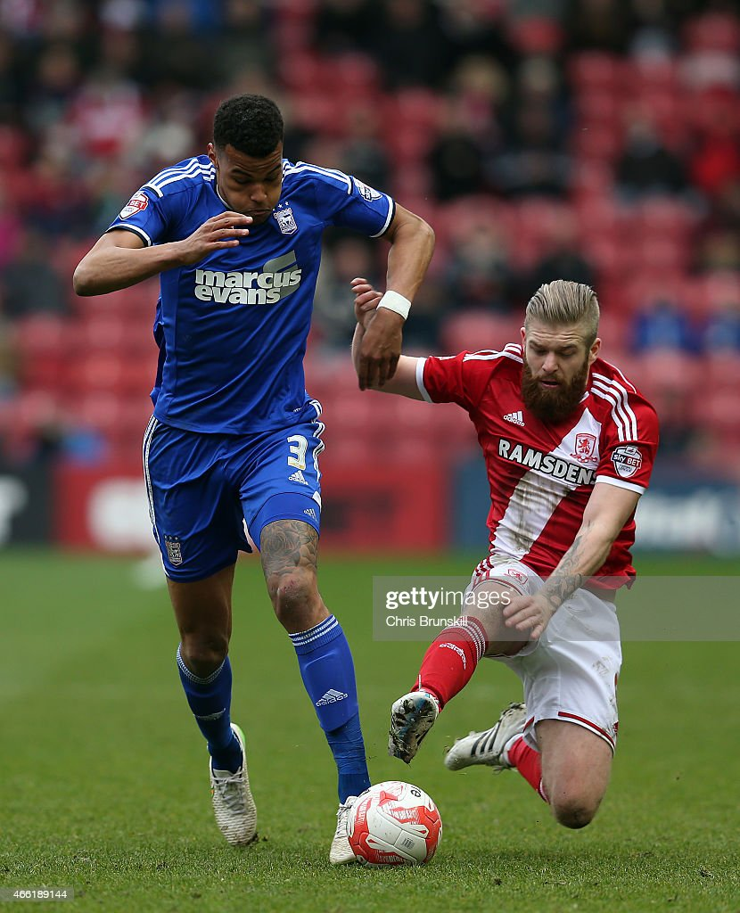 Adam Clayton of Middlesbrough challenges Tyrone Mings of Ipswich Town during the Sky Bet Championship match between Middlesbrough and Ipswich Town at the Riverside Stadium on March 14, 2015 in Middlesbrough, England.
