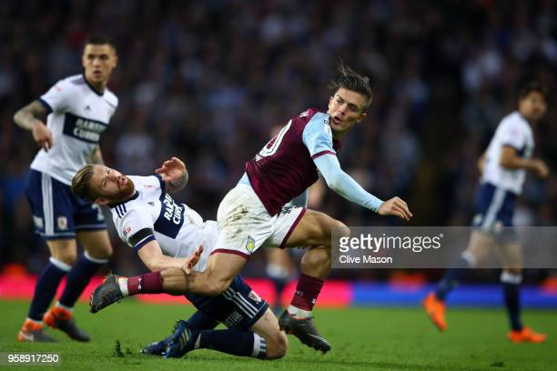 Adam Clayton of Middlesbrough collides with Jack Grealish of Aston Villa during the Sky Bet Championship Play Off Semi Final second leg match between...