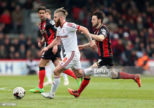 Adam Clayton of Middlesbrough holds off pressure from Marc Pugh of Bournemouth during the Sky Bet Championship match between AFC Bournemouth and...