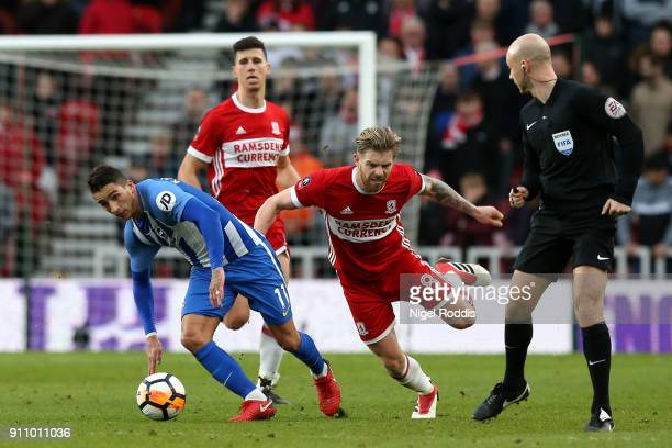 Adam Clayton of Middlesbrough is challenged by Anthony Knockaert of Brighton and Hove Albion during The Emirates FA Cup Fourth Round match between...