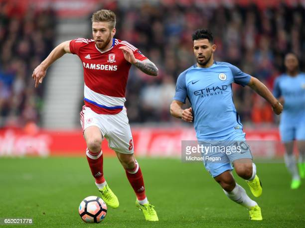 Adam Clayton of Middlesbrough is put under pressure from Sergio Aguero of Manchester City during The Emirates FA Cup QuarterFinal match between...