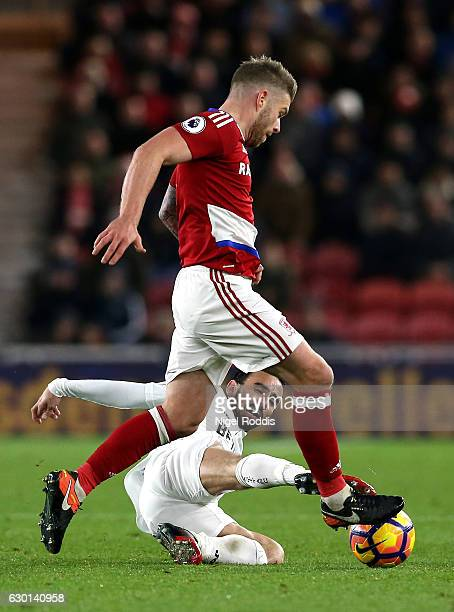 Adam Clayton of Middlesbrough is tackled by Leon Britton of Swansea City during the Premier League match between Middlesbrough and Swansea City at...