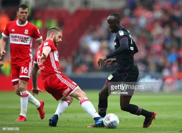 Adam Clayton of Middlesbrough tackles Albert Adomah of Aston Villa during the Sky Bet Championship Play Off Semi Final First Leg match between...