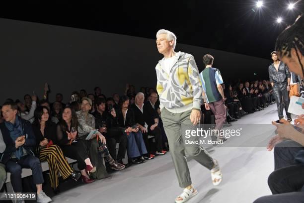 Adam Clayton walks the runway as Benedict Cumberbatch Katy England Alister Mackie Tim Blanks Editor of GQ Dylan Jones attend 'Hermes Step Into The...