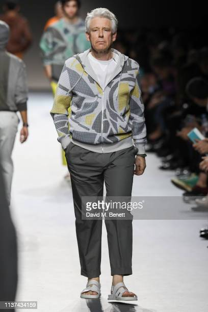 Adam Clayton walks the runway at Hermes Step Into The Frame at Nine Elms on March 21 2019 in London England