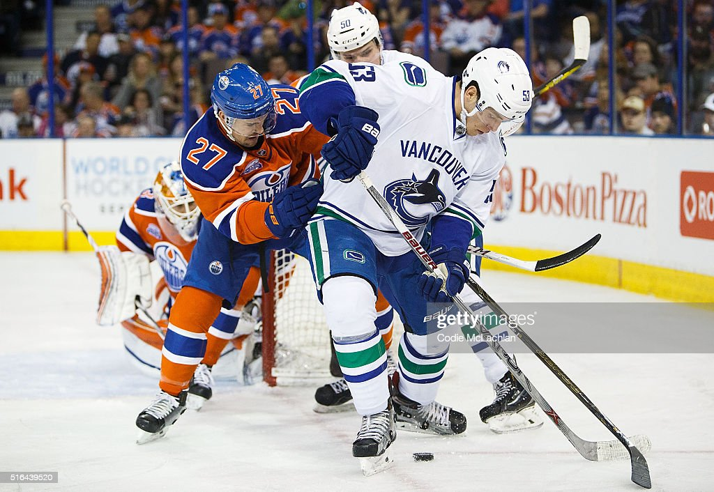 Adam Clendening #27 of the Edmonton Oilers defends against Bo Horvat #53 of the Vancouver Canucks on March 18, 2016 at Rexall Place in Edmonton, Alberta, Canada.