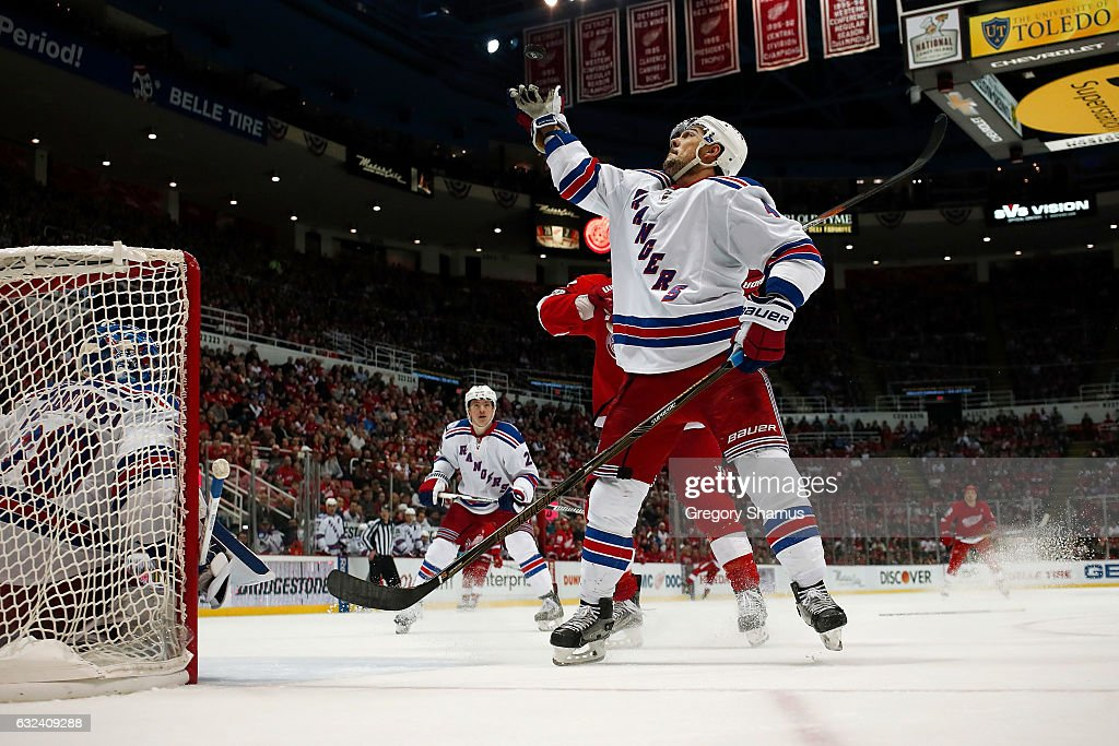 Adam Clendening #4 of the New York Rangers knocks a puck out of mid air while playing the Detroit Red Wings at Joe Louis Arena on January 22, 2017 in Detroit, Michigan. New York won the game 1-0 in overtime.