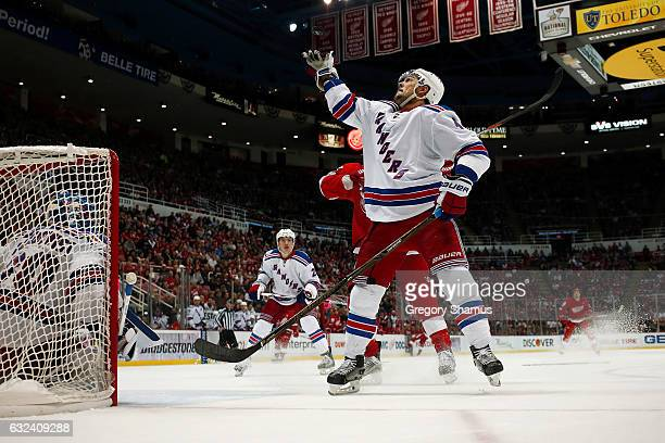 Adam Clendening of the New York Rangers knocks a puck out of mid air while playing the Detroit Red Wings at Joe Louis Arena on January 22 2017 in...