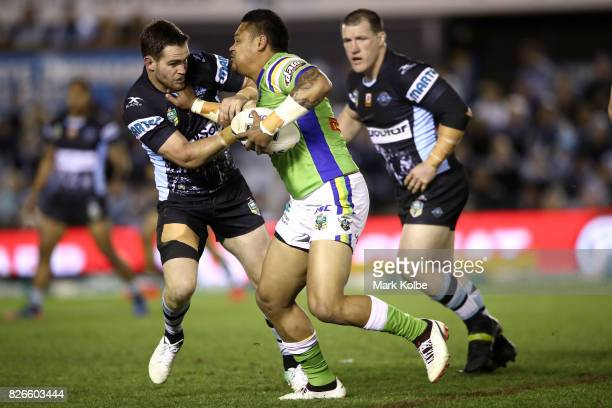 Adam Clydsdale of the Sharks is fended away by Joseph Leilua of the Raiders during the round 22 NRL match between the Cronulla Sharks and the...