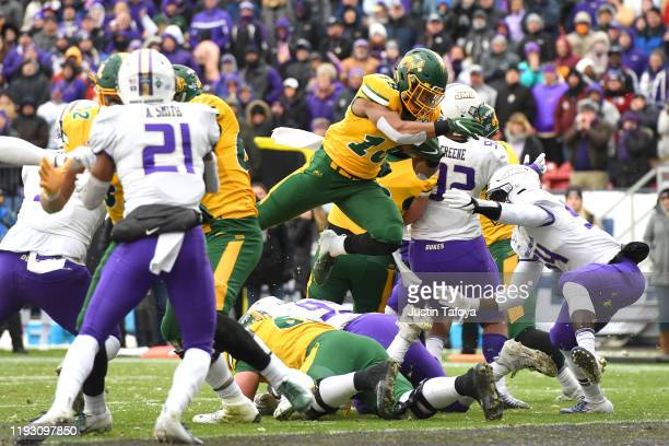 Adam Cofield of the North Dakota State Bison scores a touchdown against the James Madison Dukes during the Division I FCS Football Championship held...