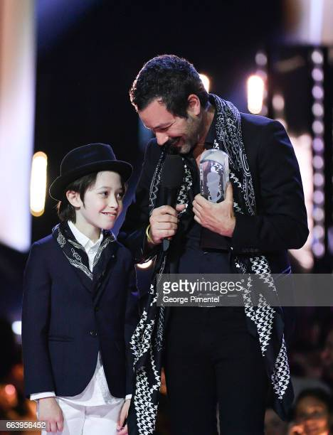 Adam Cohen son of the late Lenoard Cohen and Adam's son Cassius received award for the late Lenoard Cohen at the 2017 Juno Awards at The Canadian...