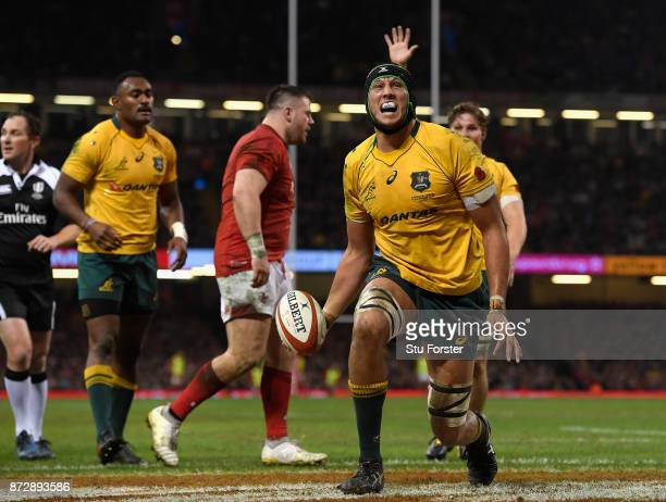Adam Coleman of Australia celerbates scoring his sides second try during the Under Armour Series match between Wales and Australia at Principality...