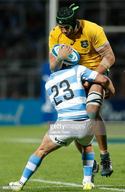Adam Coleman of Australia is tackled by Santiago Cordero of Argentina during The Rugby Championship match between Argentina and Australia at Malvinas...