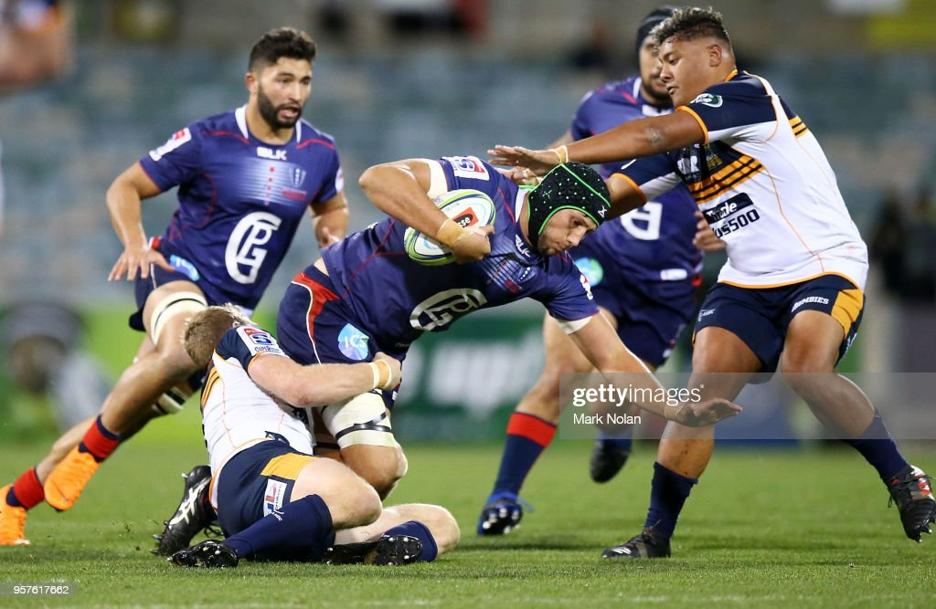 Adam Coleman of the Rebels is tackled during the round 12 Super Rugby match between the Brumbies and the Rebels at GIO Stadium on May 12, 2018 in Canberra, Australia.