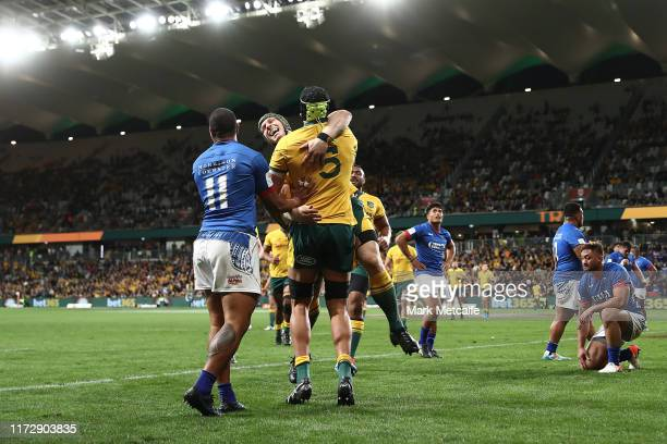 Adam Coleman of the Wallabies celebrates scoring a try with team mate David Pocock during the International Test match between the Australian...