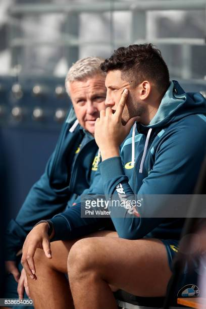 Adam Coleman of the Wallabies sits off the field with a shoulder injury during a Australia Wallabies Captain's Run at Forsyth Barr Stadium on August...