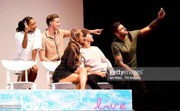 Adam Collard Eyal Booker Georgia Steele Dr Alex George and Samira Mighty pose for a selfie attending the Love Island Live photocall at the ExCel...