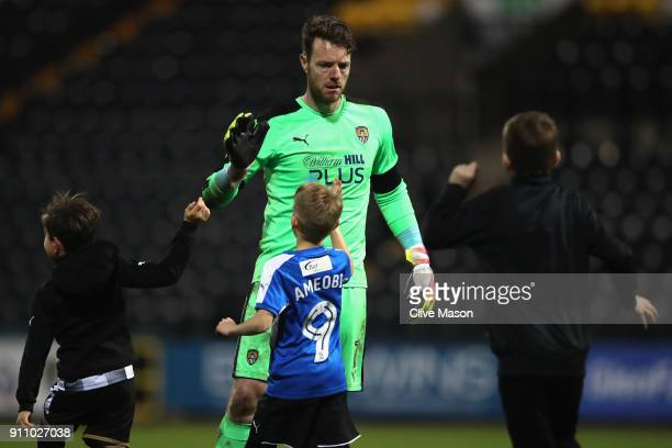 Adam Collin of Notts County celebrates with young supporters during The Emirates FA Cup Fourth Round match between Notts County and Swansea City at...