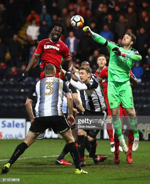 Adam Collin of Notts County clears from Wilfried Bony of Swansea City during The Emirates FA Cup Fourth Round match between Notts County and Swansea...