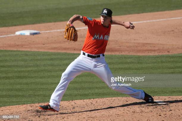 Adam Conley of the Miami Marlins throws the ball against the Boston Red Sox during a spring training game at Roger Dean Chevrolet Stadium on March 9...