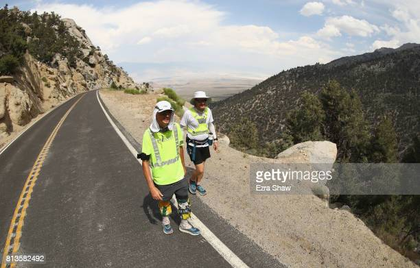 Adam Connor of Australia walks with a member of his support crew to the Whitney Portal during the STYR Labs Badwater 135 on July 12 2017 in Death...