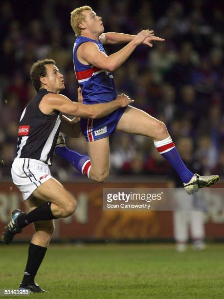 Adam Cooney for the Bulldogs and James Clement for Collingwood in actionn during the AFL round 22 match between the Western Bulldogs and Collingwood...