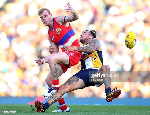 Adam Cooney of the Bulldogs and Chris Masten of the Eagles contest for the ball during the round one AFL match between the West Coast Eagles and the...