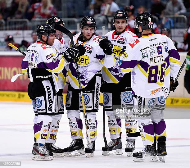 Adam Courchaine of Krefeld Pinguine celebrates the first goal during the DEL Ice Hockey match between Koelner Haie and Krefeld Pinguine at Lanxess...