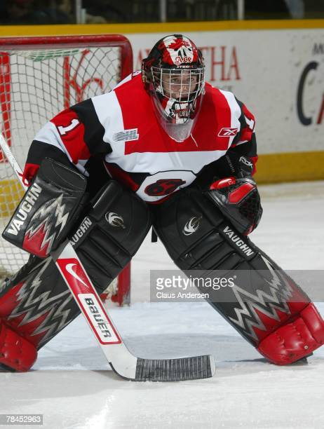 Adam Courchaine of the Ottawa 67's gets set to face a shot in a game against the Peterborough Petes on December 6 2007 at the Peterborough Memorial...