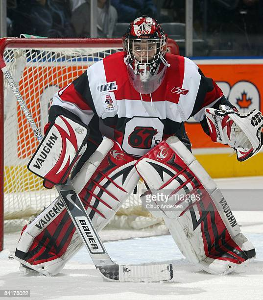Adam Courchaine of the Ottawa 67's watches the play in a game against the London Knights on January 4, 2009 at the John Labatt Centre in London,...
