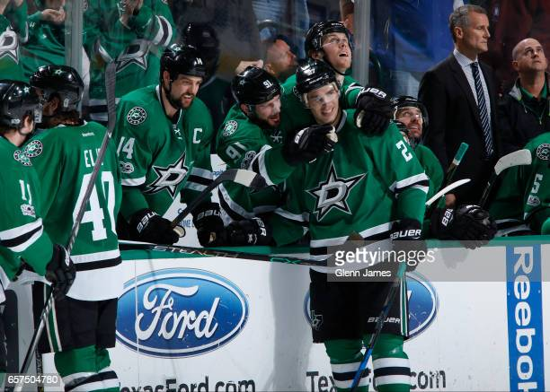 Adam Cracknell and his Dallas Stars teammates celebrate a goal for his first career hattrick against the San Jose Sharks at the American Airlines...