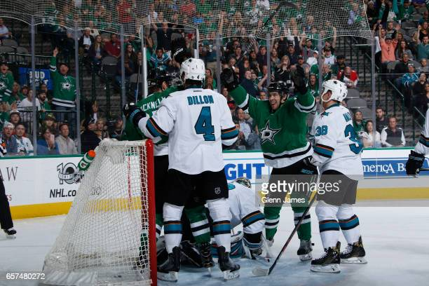 Adam Cracknell Curtis McKenzie and the Dallas Stars celebrate a goal against the San Jose Sharks at the American Airlines Center on March 24 2017 in...