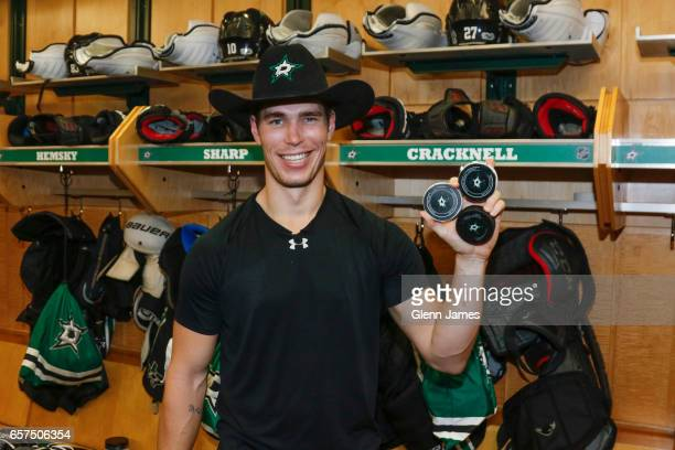 Adam Cracknell of the Dallas Stars poses with the pucks from his first career hattrick against the San Jose Sharks at the American Airlines Center on...