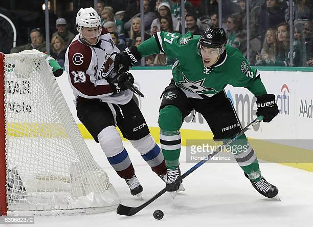 Adam Cracknell of the Dallas Stars skates the puck against Nathan MacKinnon of the Colorado Avalanche in the third period at American Airlines Center...