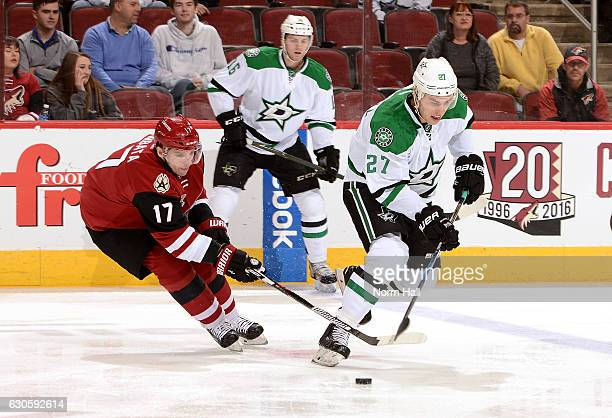 Adam Cracknell of the Dallas Stars skates with the puck while being defended by Radim Vrbata of the Arizona Coyotes at Gila River Arena on December...