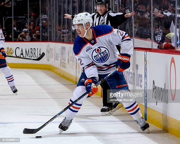 Adam Cracknell of the Edmonton Oilers plays the puck down the ice during second period action against the Winnipeg Jets at the MTS Centre on March 6...