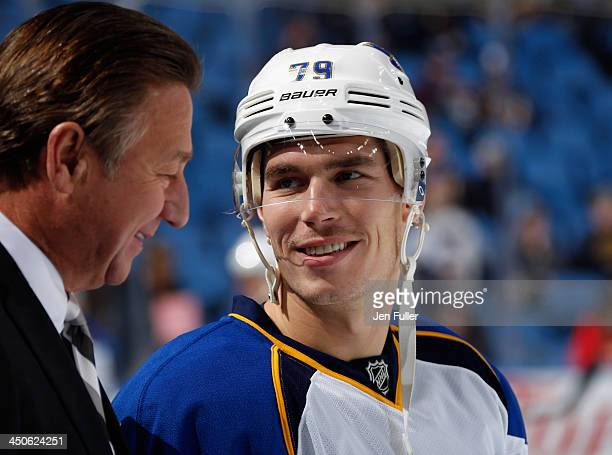 Adam Cracknell of the St Louis Blues talks to broadcaster Bernie Federko prior to playing the Buffalo Sabres at First Niagara Center on November 19...