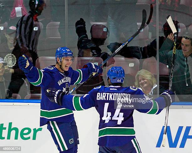 Adam Cracknell of the Vancouver Canucks celebrates his overtime goal with teammate Matt Bartkowski during their game against the San Jose Sharks...