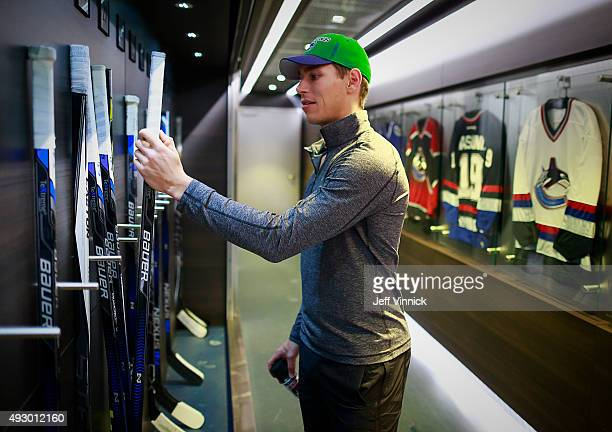 Adam Cracknell of the Vancouver Canucks checks his sticks before their game against the St Louis Blues at Rogers Arena October 16 2015 in Vancouver...