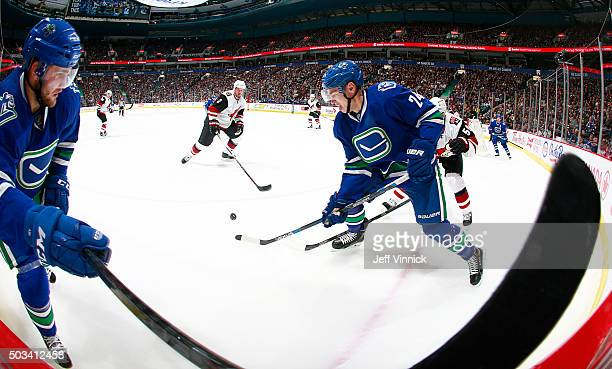 Adam Cracknell of the Vancouver Canucks plays the puck against the Arizona Coyotes during their NHL game at Rogers Arena January 4 2016 in Vancouver...