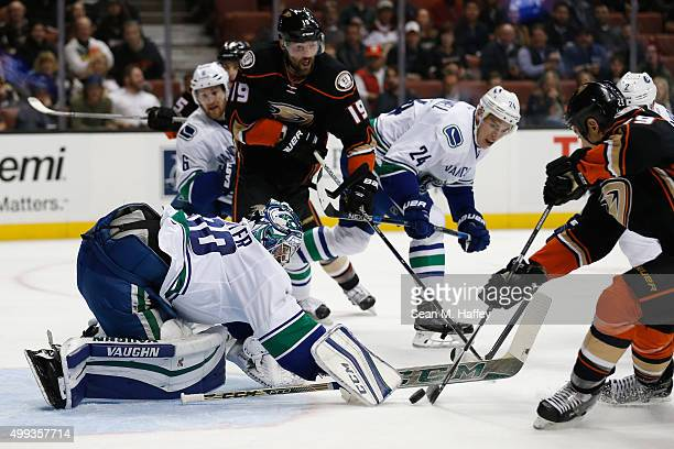 Adam Cracknell of the Vancouver Canucks Ryan Miller of the Vancouver Canucks defend against Patrick Maroon of the Anaheim Ducks and Chris Stewart of...