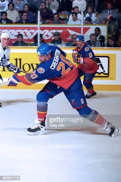 Adam Creighton of the St Louis Blues skates against the Toronto Maple Leafs during NHL game action on November 28 1995 at Maple Leaf Gardens in...