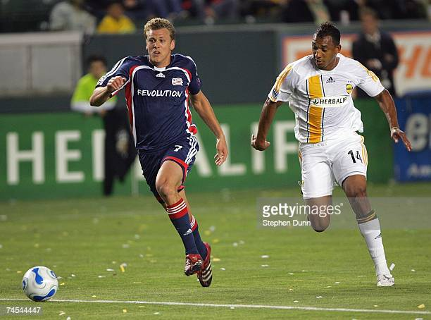 Adam Cristman of the New England Revolution and Tyrone Marshall of the Los Angeles Galaxy pursue the ball during their MLS match on May 12 2007 at...