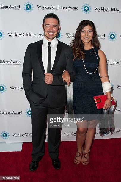 Adam Croasdell and Alicia Free arrive at the World Of Children Award 2016 Alumni Honors at the Montage Beverly Hills on April 12 2016 in Beverly...