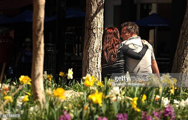 Adam Cruz right and his girlfriend Abby DeNicsio left enjoy a quiet moment together with the warm sunshine and budding flowers on the Pearl Street...