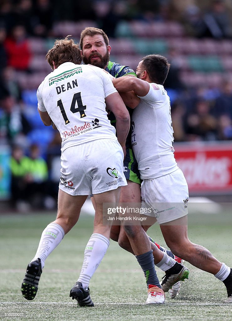 Adam Cuthbertson of Leeds Rhinos is tackled by Chris Dean of Widnes Vikings during the First Utility Super League match between Widnes Vikings and Leeds Rhinos at Select Security Stadium on February 14, 2016 in Widnes, England.